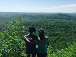 two girls look over a scenic view